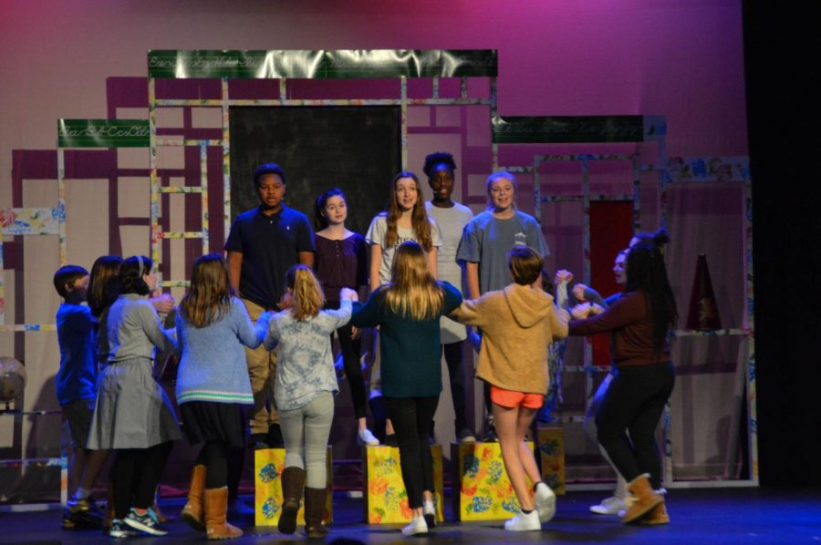 """From left to right: Jamez Jordan, Kate Vento, Angelina David, Deja Harris, and Mary Alice Vento stand on boxes during """"What is a Noun"""" as the cast circles.  This song is the opening musical number for the play."""