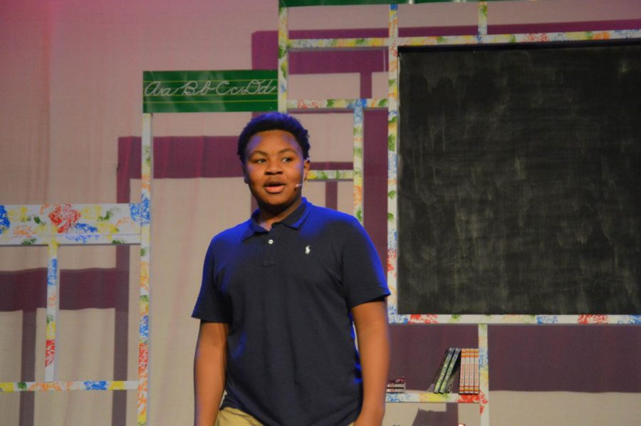 """Jamez Jordan does a mic check before the start of """"What is a Nouns"""". Jordan played a leading role in the musical as George."""