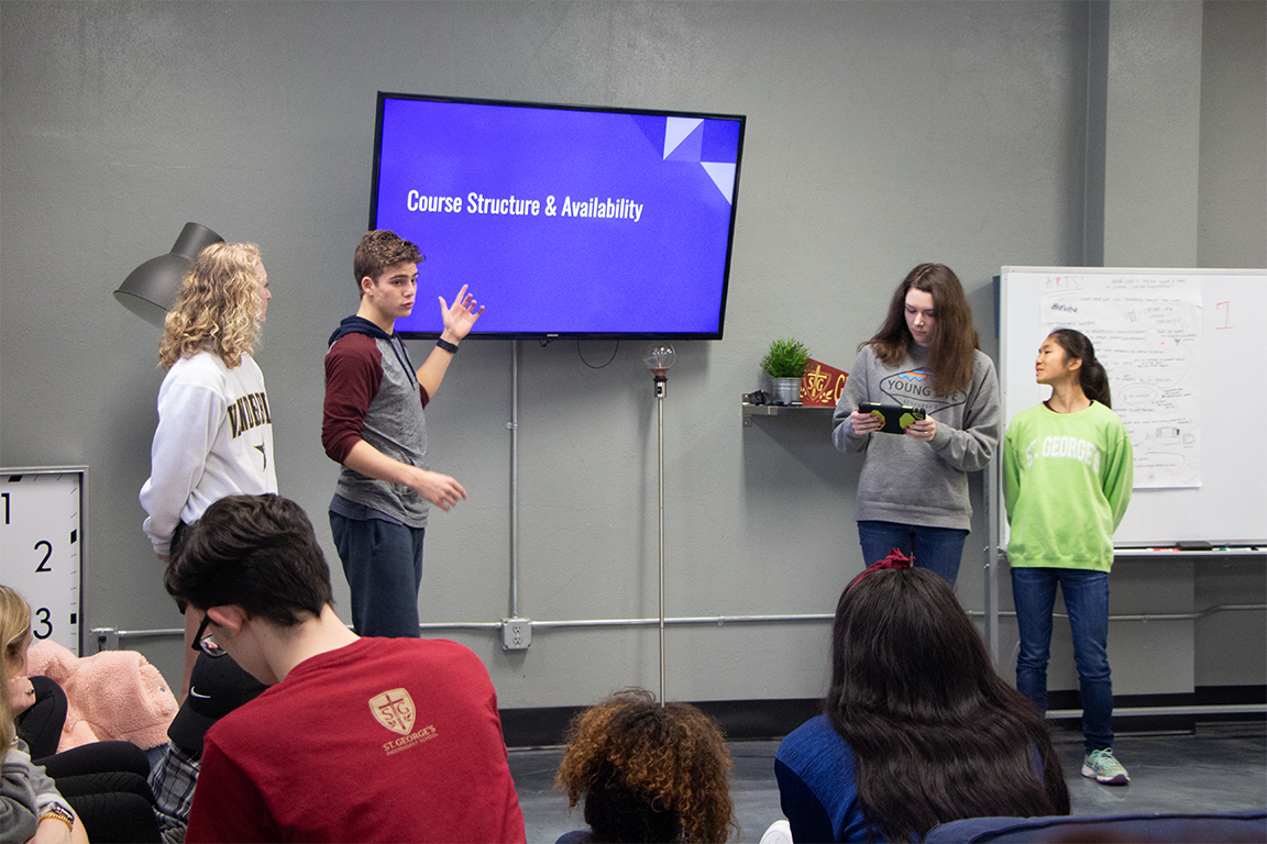 Juniors Anna Larizza, Silas Rhodes, Natalie Murrah and Sarah McDonald present their proposal to their classmates and heads of school. They hoped the restructuring of electives would make more available earlier in high school students' careers.