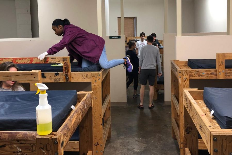 Students of 7th period study hall help clean up bunk rooms for the SOS church. They spent the day cleaning up the church and listening to leaders explain why helping out the community is important.