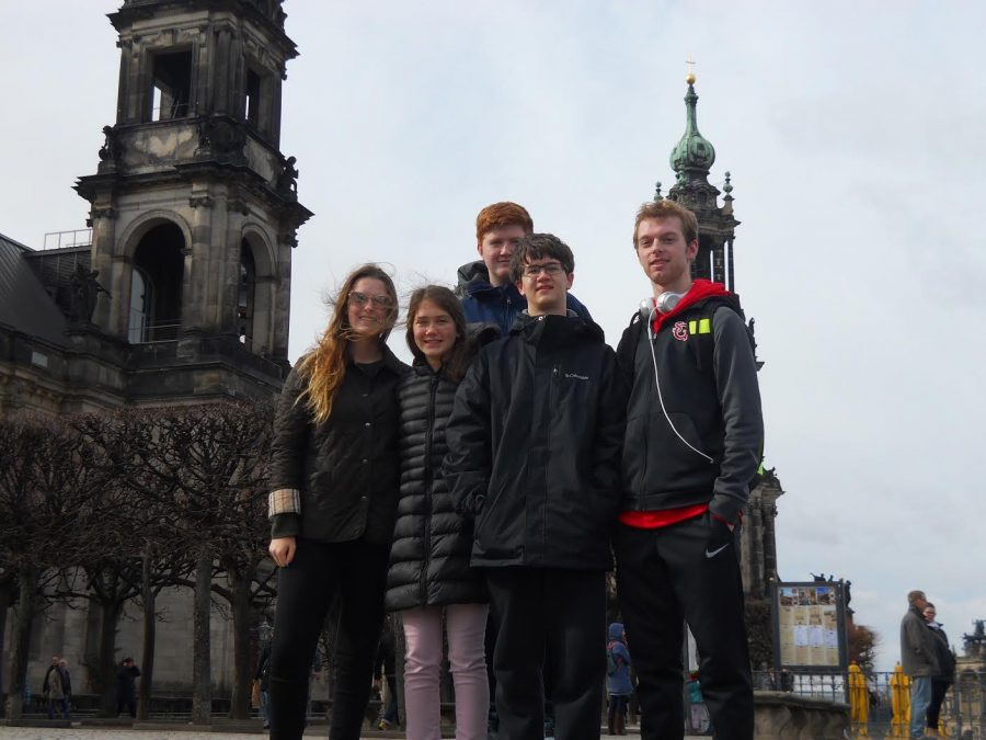A+group+of+students+stop+to+take+a+picture+in+Dresden+by+the+waterfront.+They+visited+Prague+for+two+days.