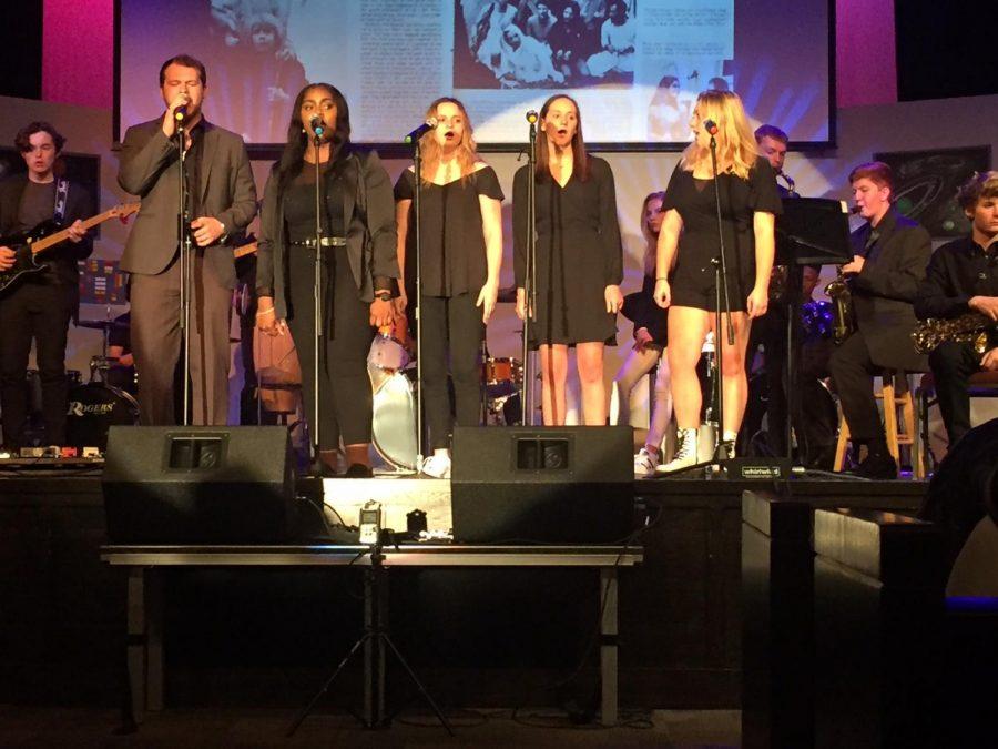 Members of the Modern Music Ensemble and Concert Choir sing