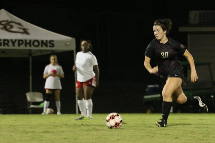 Junior Ella Sykes eyes down the ball during a match against Harding. Soccer started the year with some tough losses, but look to improve in regional play.