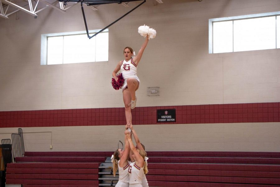 Allison Evans 20' and the cheer team perform a cheer at a pep rally. The cheer team helps support the Gryphons at every football game.