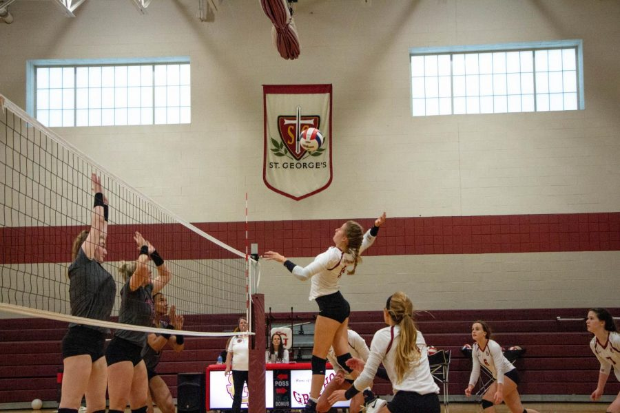 Adi Thrasher 20' jumps up to spike the ball while the rest of the team covers. The #NetGryphs have had an impressive season!