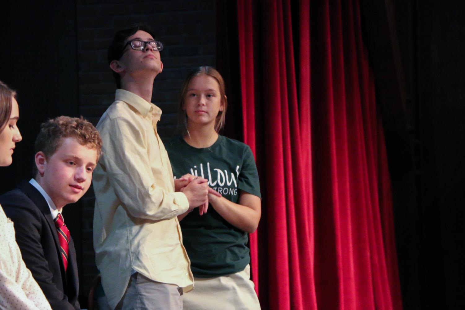 Sophomore Nicolas Gutierrez, senior Miles Masters and junior Caroline Hill rehearse a scene for the upcoming play. The cast of nine has been practicing their lines and British accents since the beginning of September.