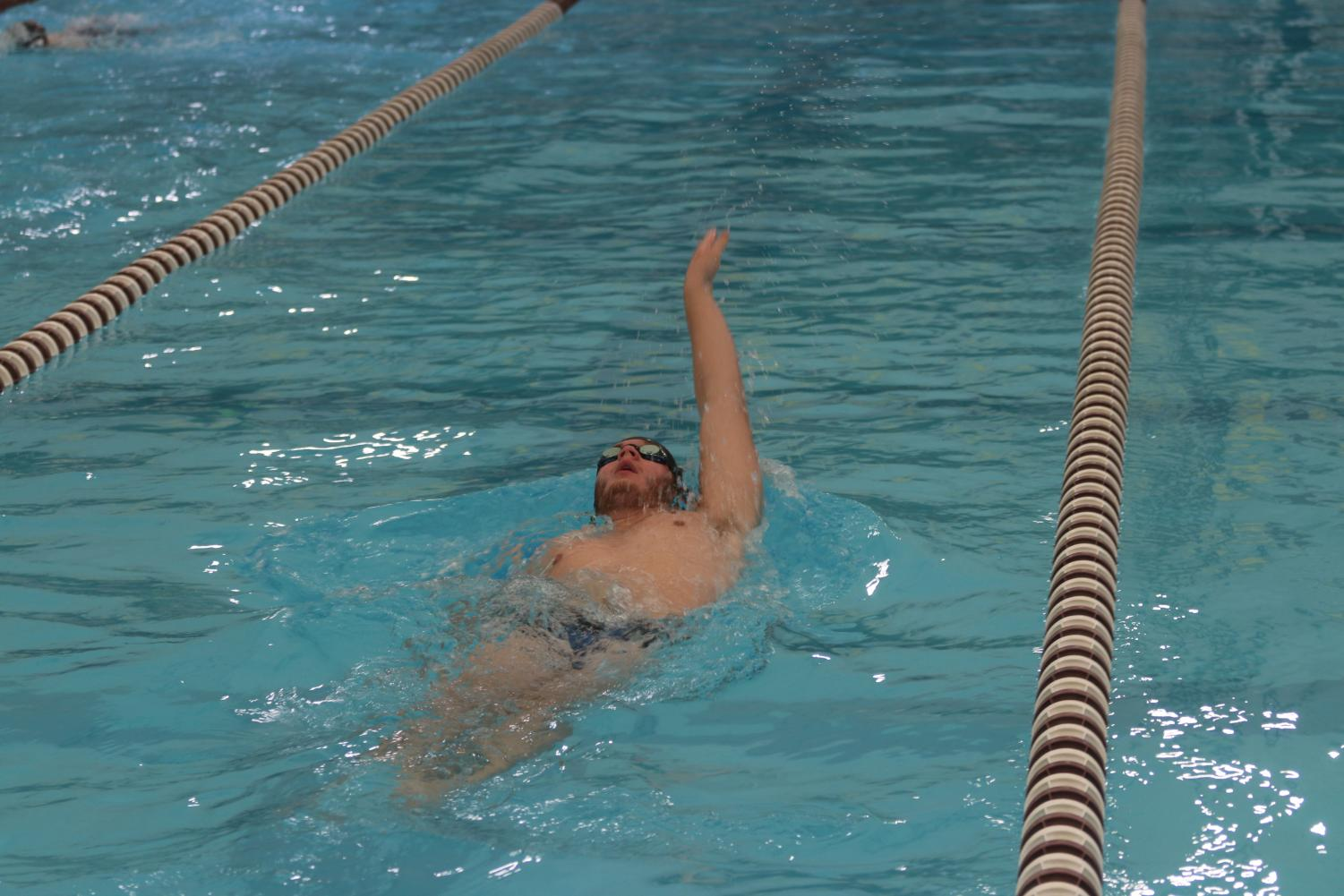 Senior, Luke Stevens, working on backstroke during practice. The team engages in time trials to see how quickly they are improving.