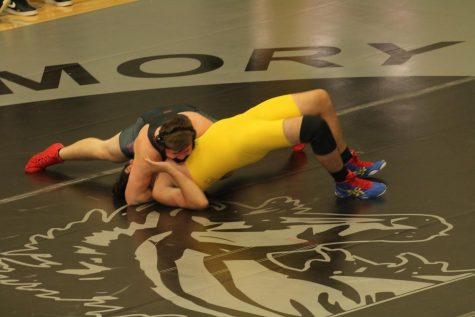 Josh Taube grapples with his opponent as he goes for a pin to win the match. This match was part of a tournament at Houston High School.