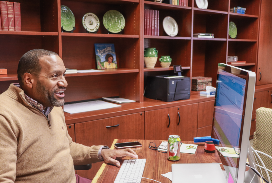 (Photo on file) Interim Head of School Mr. Timothy Gibson works at his desk during the winter of last year. Mr. Gibson has been a St. George's faculty member since 2009.
