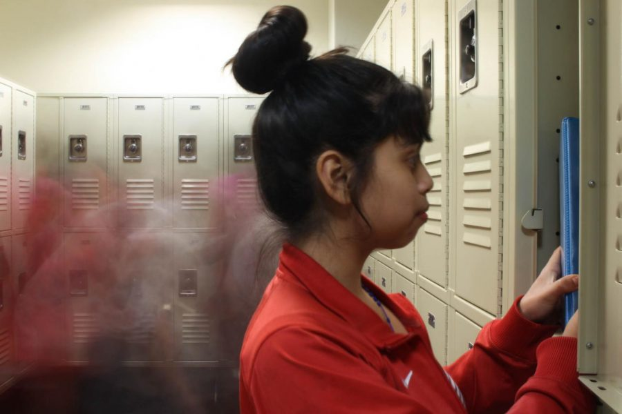 Eighth+grader+Jennifer+Lopez+poses+looking+through+her+locker.+In+the+whirl+of+%0Aeveryday+school+life%2C+students+can+feel+overlooked.