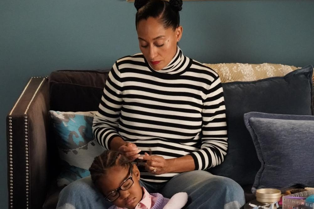 The photo from the episode of Black-ish  is a flashback to a point in time when Rainbow styled Diane's hair.