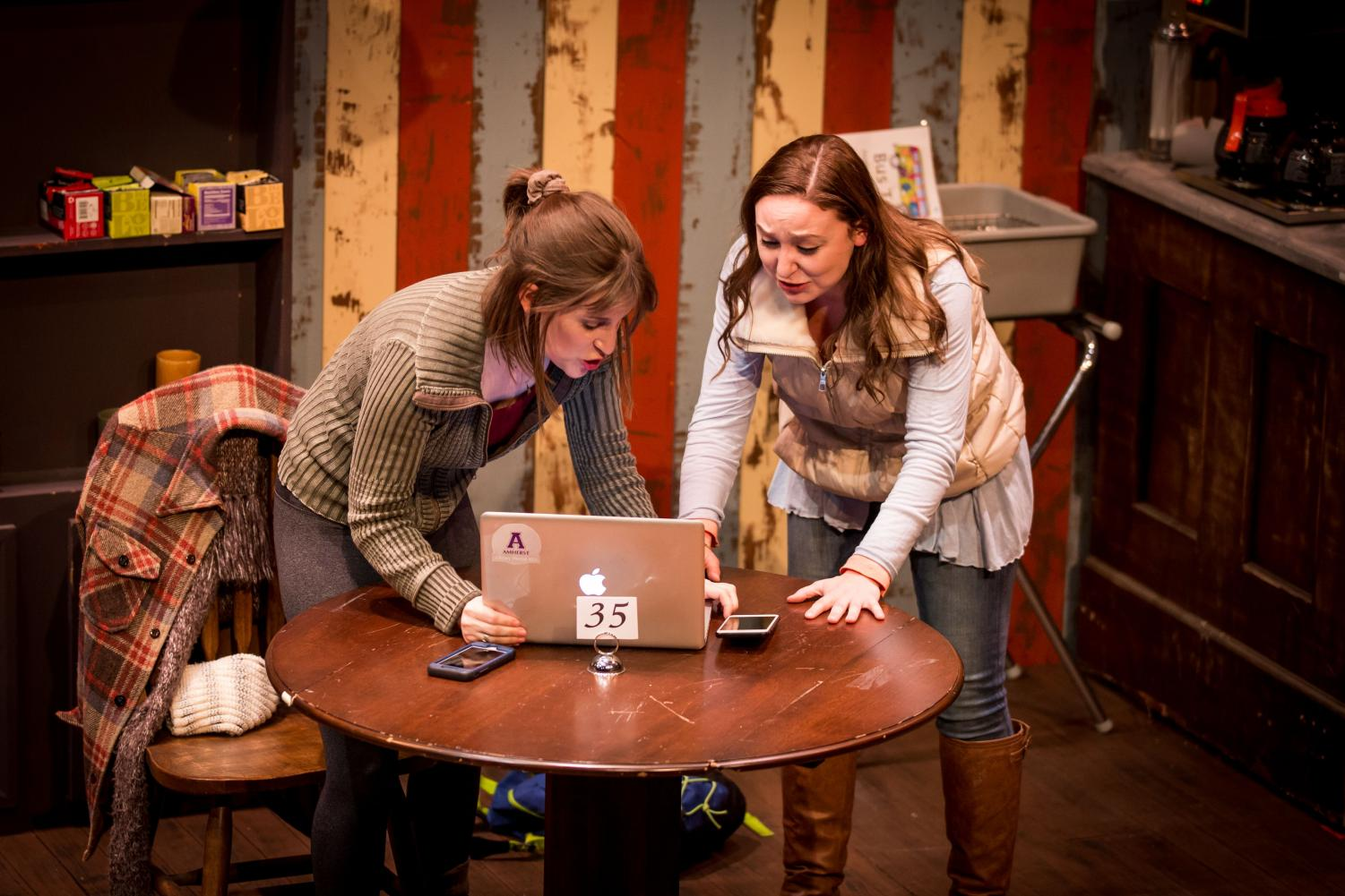 """Tracy, played by Brooke Papritz, and Nadyia, played by Caroline Simpson, panic at Tracy's computer in one of the final scenes of """"When We Get Good Again."""" This new work premiered Jan. 10 and runs through Jan. 26."""