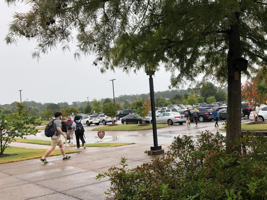 Seniors walk to their cars after the announcement of the suspension of in-person learning for the upper school. Dismissal occurred shortly after lunch.