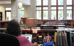 The library sits empty as Ms. Allison works before the sophomore lunch crowd.