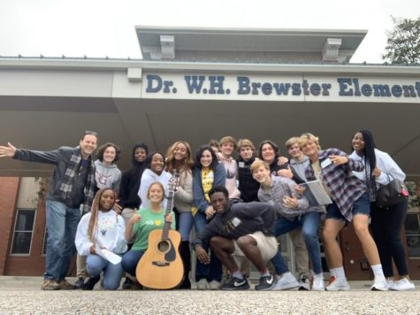 Mr. Hills stands with members of the Institute for Citizenship in front of Dr. W.H. Brewster Elementary School, which was the site of a service project last year. Mr. Hills had to rely on the members to find the focus of their service this year. Photo courtesy of Joy Huff.
