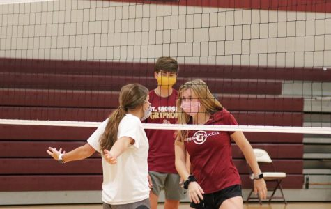 Sophomore Mary Wilkes Dunavant taunts Junior Ally Martin during the St. George's Volleyball House Challenge. The players for the House Challenge, held on the morning of September 4th, consisted of only Freshmen, Sophomores, and Juniors.