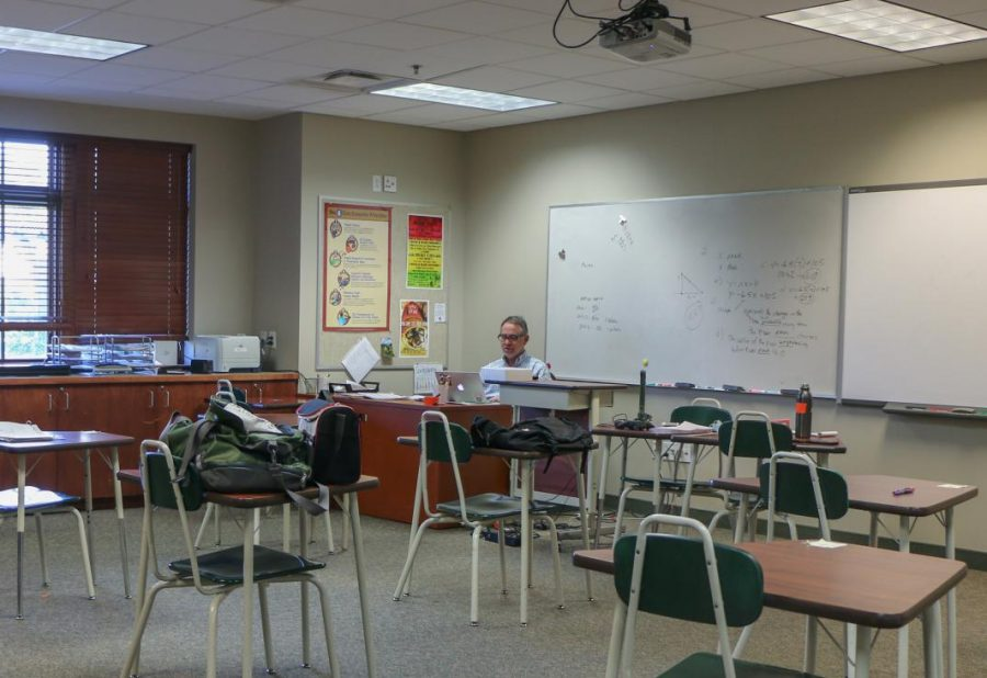 Bruce Timmons sits in his empty classroom while students are remote due to COVID-19. Canvas played an essential role in allowing students to learn from home.