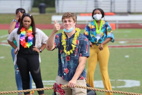 Wes Smith, class of 2021, gives the go ahead for the tug of war game to start. Smith serves as the president of student government.