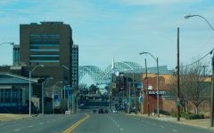 The Hernando de Soto Bridge is framed between several buildings on Poplar Avenue. Memphis was one of several cities that was hit hard amid shut downs of businesses during the COVID-19 pandemic.