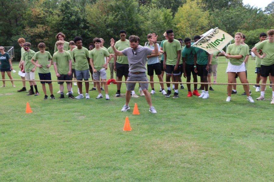 Mr.+Ferguson+readies+the+students+to+start+a+new+game+of+tug+of+war.+Each+house+competed+against+each+other+to+determine+a+final+champion.